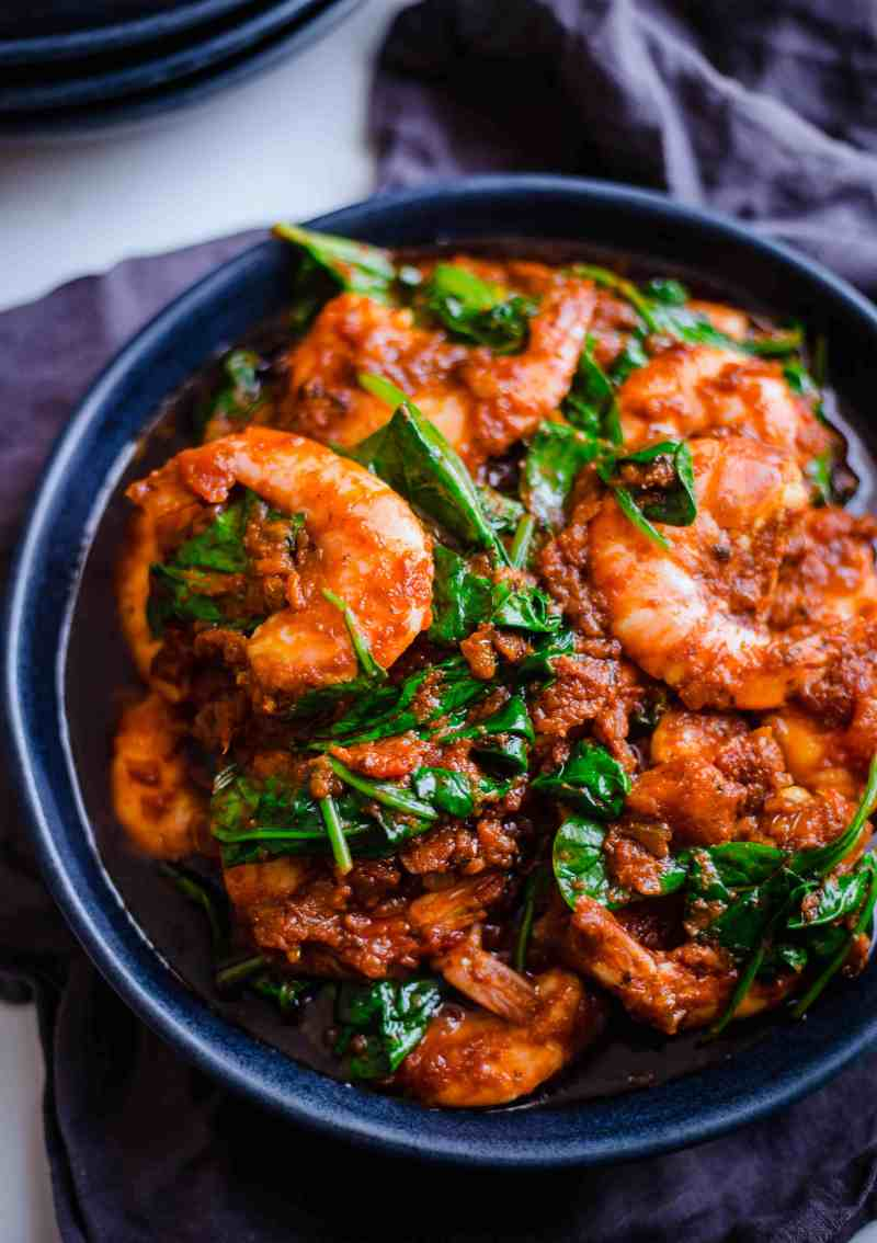 Prawn and Spinach Curry in a blue bowl on a table