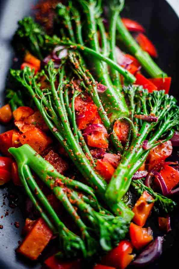 Tendereste Broccoli with red pepper in a black oval dish