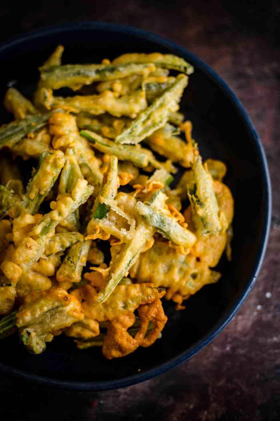 Okra Fries in batter in blue bowl