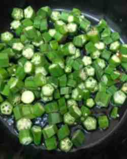 Okra added to oil in pot