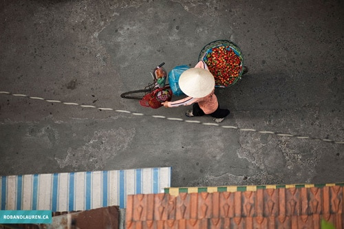Man On A Bicycle, Ho Chi Minh City by Rob & Lauren Lim