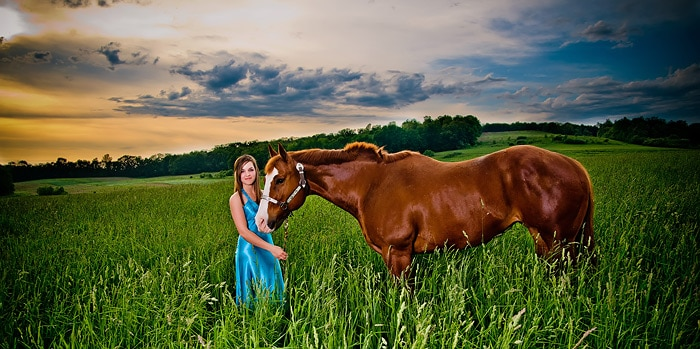 High School Senior In The Meadow With Her Horse