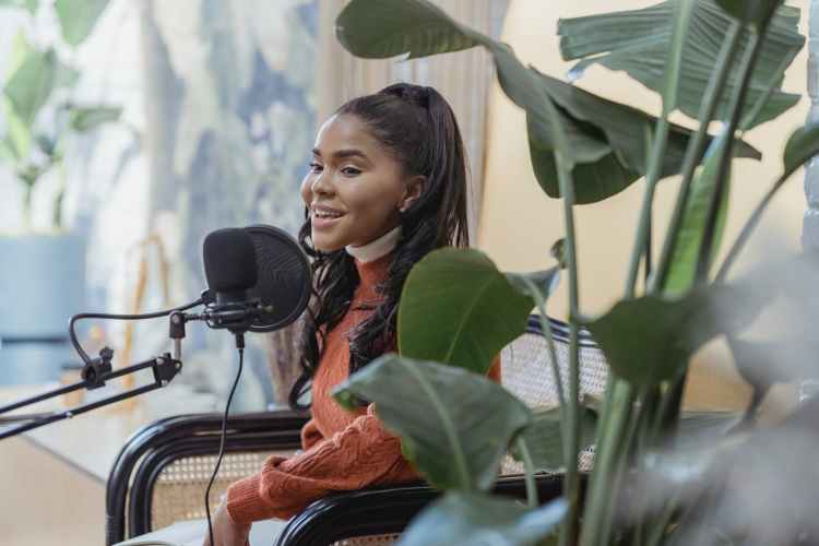 happy young black woman singing during radio program