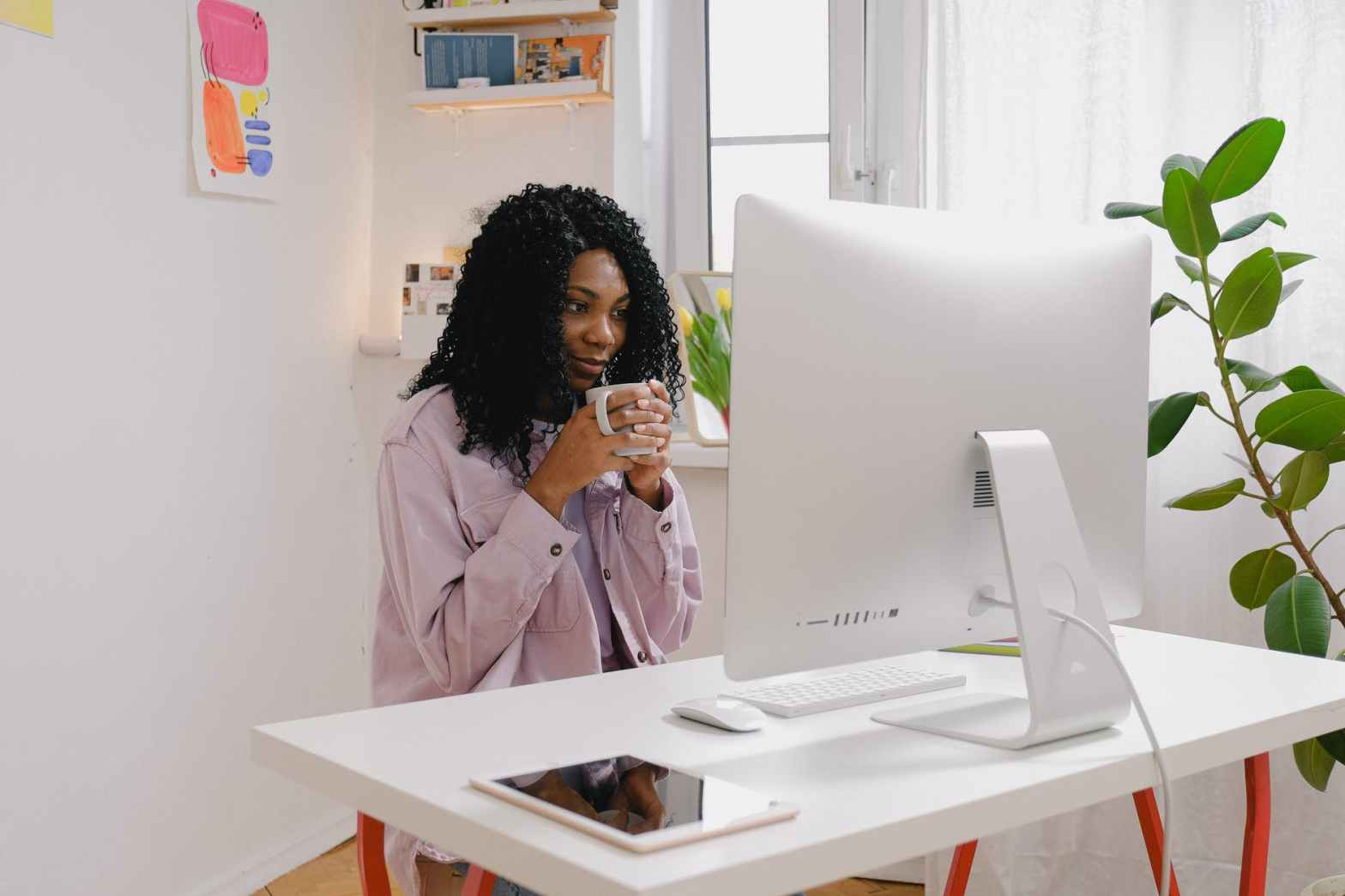 young black woman freelancing with computer at home