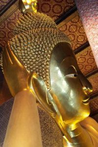 close up of reclining buddha at wat pho bangkok