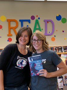 Librarian & #vted Reads host Jeanie Phillips (l.) stands next to Vermont educator Corey Smith, who's holding a copy of The Benefits of Being an Octopus