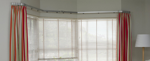 curved curtain rods at best price in