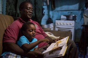 "On 16 August 2016 in Belize, Marshall Mejia reads a bedtime story to his son, 4-year-old Orin Mejia, in the home of Orin's mother, in the town of Dangriga, on the south-eastern coast. Orin, whose parents are not together, stays at his mother's home at night-time and with his father, Marshall Mejia, during the day. His father's house is two minutes away by bicycle, and both homes are located just a few hundred metres from the sea. Mr. Mejia, who is a preschool teacher, understands the importance of exposing children to learning materials and a stimulating environment from a young age. ""We must prepare children for school long before they arrive in the classroom, only then are they able to benefit fully from the teachings,"" he says. Orin, who graduated from the Kids First Child Development Centre preschool and begins primary school in September, has a wide-ranging vocabulary. He loves to read, or be read to by his father at bedtime. Mr. Mejia's activities with his son also include trips to the seaside – to swim at the beach and to see what fishermen at the pier have caught – and to the park to play. In recent years, considerable progress was made in the area of Early Childhood Development. In 2011 only 32 per cent of children between 36 and 59 months of age attended an Early Childhood Education (ECE) programme, but this reached 55 per cent by 2015. Disparities however persist as only one in five of the poorest children attend ECE, and the Cayo district sees the lowest ECE attendance rate (36 per cent).  Further success is contingent upon removing barriers to supply of services, such as sufficient number of qualified professionals and greater integration of the different ECD components. The recent adoption of a national ECD policy demonstrates the Government's commitment to strengthening ECD services.   UNICEF and the World Health Organization (WHO), with their national, regional and country partners, promote the use of a range of effective interv"