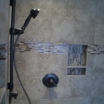 Kerdi shower remodel with glass and travertine