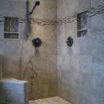 Porcelain, glass, travertine Kerdi tile shower in Fort Collins