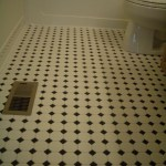 Octagonal mosaic tile floor installation with black dot in Fort Collins, CO