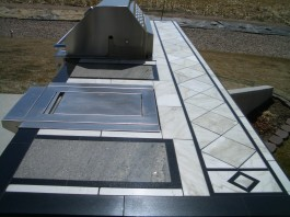 Barbeque island countertop with marble and granite