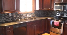 Dark glass kitchen tile backsplash in Fort Collins, CO