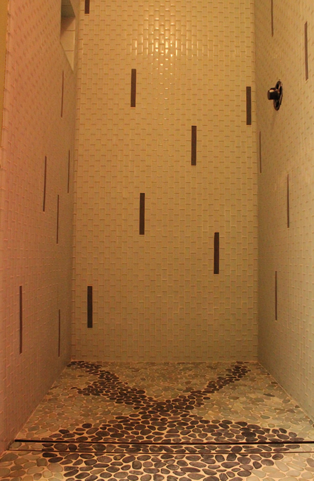 glass tile shower with a linear drain
