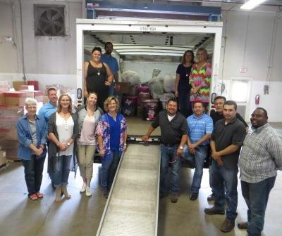 Dal-Tile Employees Packing Donated Items For Fellow Teammates.