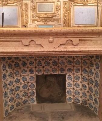 Gorgeous fireplace adorned with vintage Delft tile spotted during our tour of the Palazzo Ducale di Sassuolo.