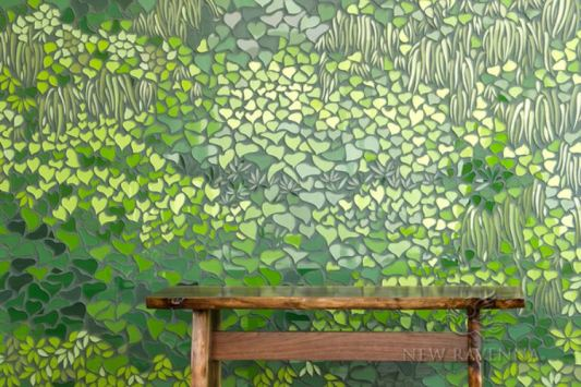 Living Wall, a waterjet mosaic, shown in shades of green Serenity glass, is part of the Broad Street collection.