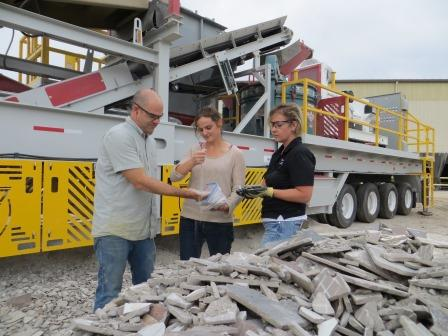 Employees in Front of Dal-Tile's Mobile Tile Crusher