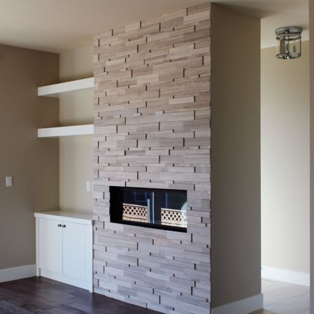 Wooden White Cubic Ledgestone installed on a fireplace
