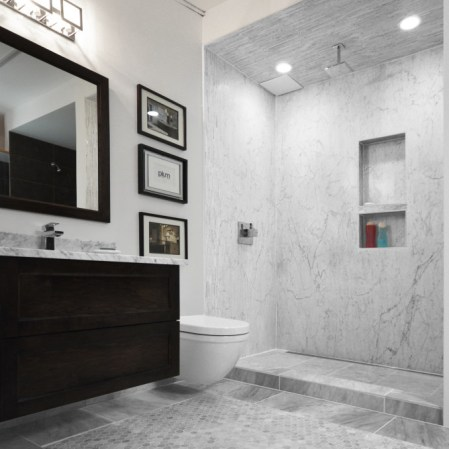 Plum Install of Marble in a bathroom