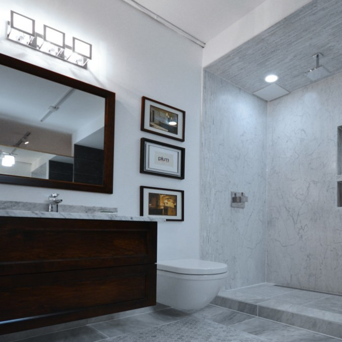 Plum Install of Marble Tile in a bathroom