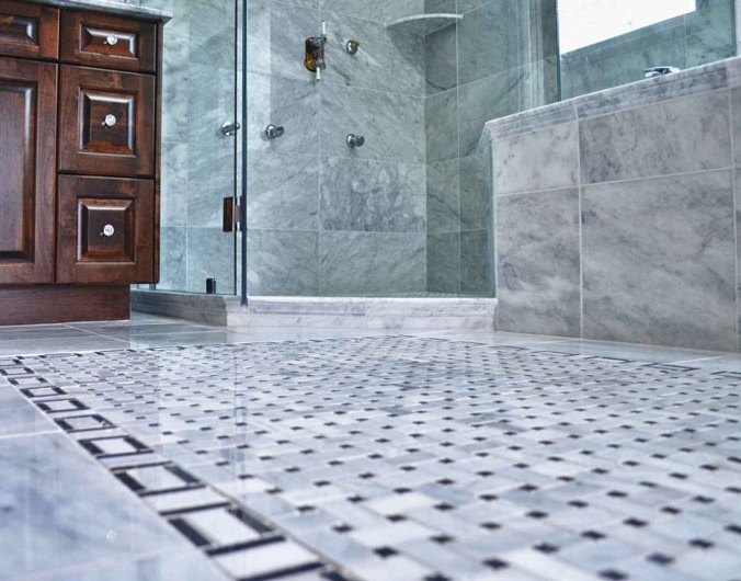 Marble stone installed on a bathroom floor, tub surround and shower