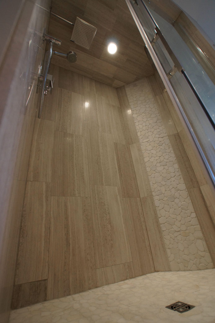 Wooden White Marble and Snowflake Pebbles Mosaic installed in a shower