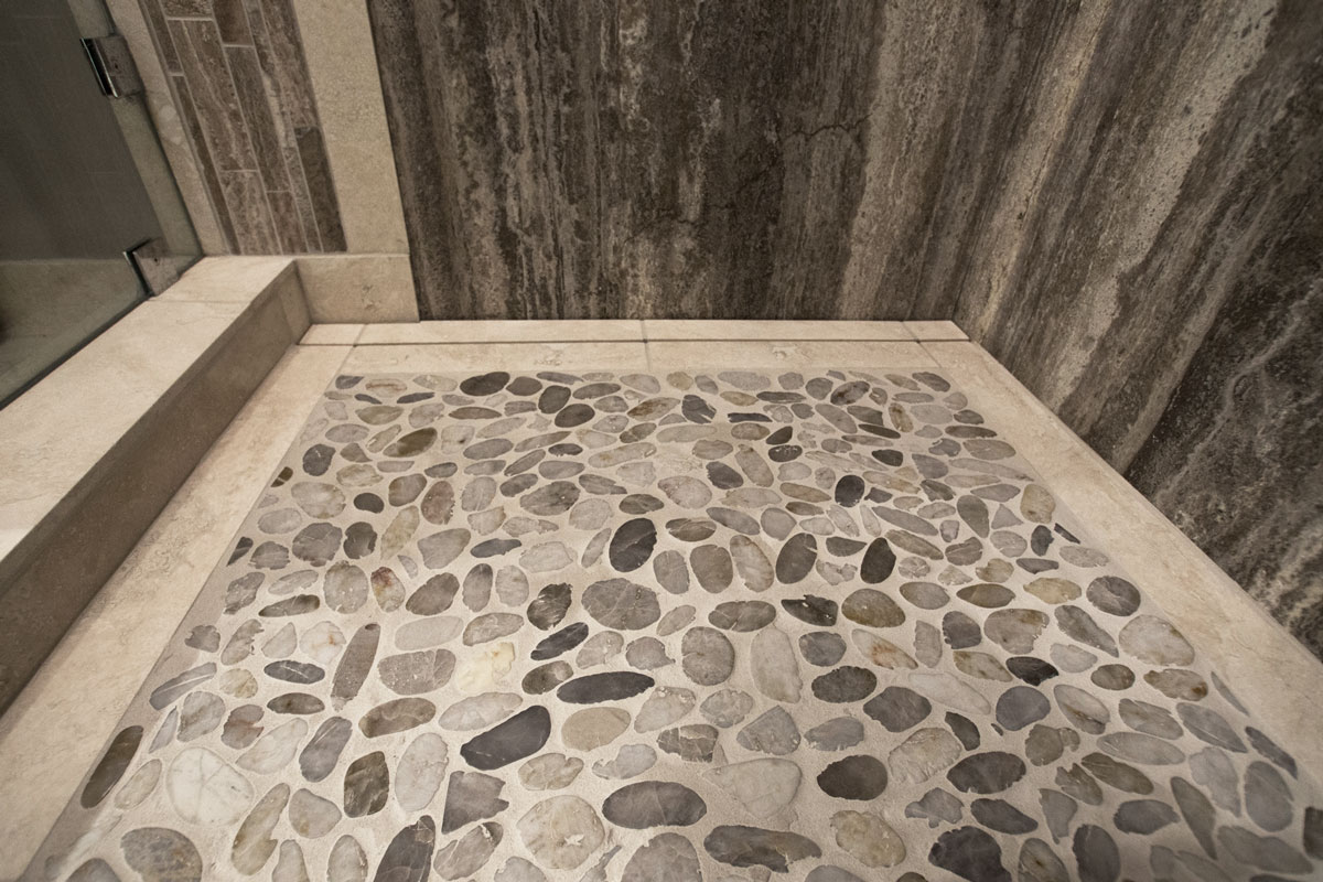 Kootenay Pebbles & Baja White installed in a shower base