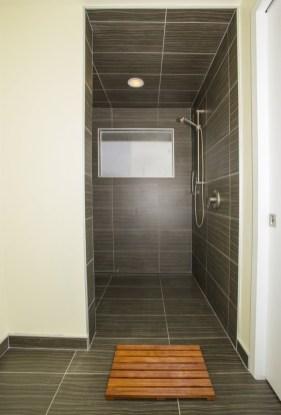 Twine Dark Porcelain Tile Installed in a shower