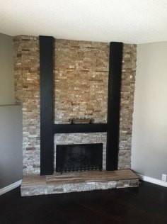Cosme Random Strip Splitface Ledgestone and Cosme Veincut Tile installed on a fireplace