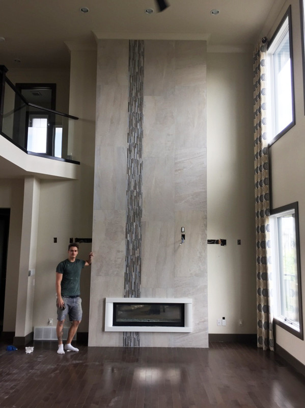 Riviera Lune porcelain and Stainless Blend Twilight Mist Mosaic installed on a fireplace