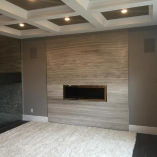 Wooden White Bolder Stone Panel installed on a fireplace