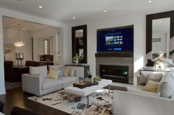 Persian Silver Bolder Panel installed on a fireplace surround