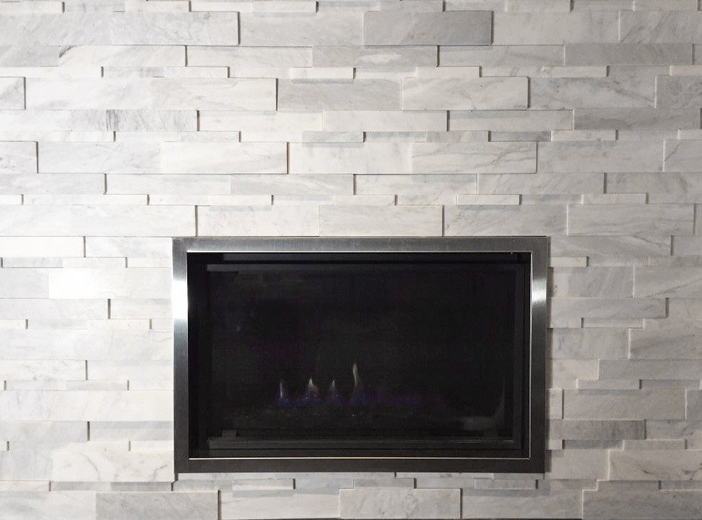 Bianco Cobalt Marble Cubic Ledgestone installed on a fireplace