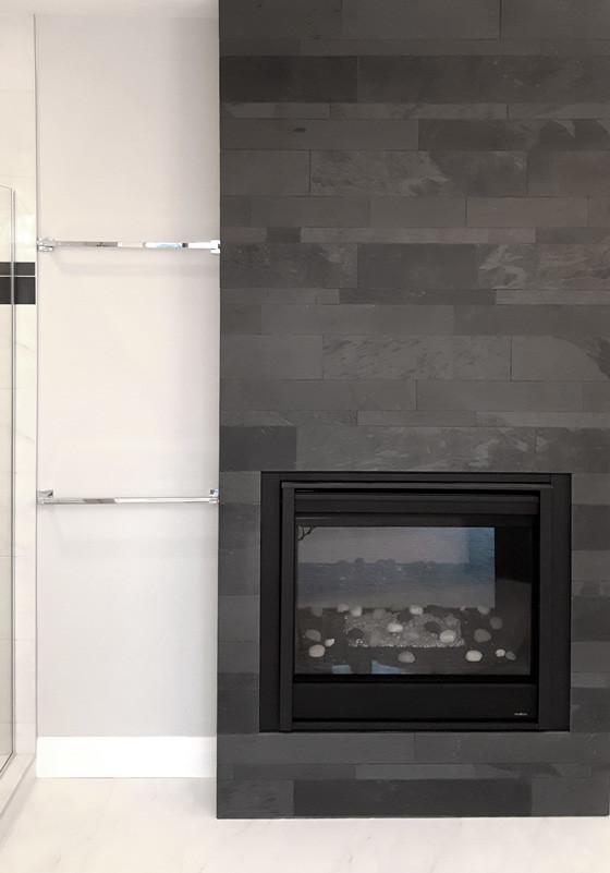 Lava Black Slate Strips installed on a fireplace