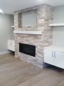 Ritz Grey Cubic Ledgestone installed on a fireplace