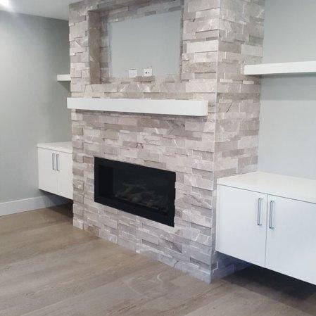 Ritz Grey Cubic Ledgestone installed on a fireplace