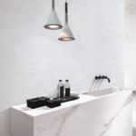 Sculpture Fossil White 24x48 Porcelain Tile installed in a bathroom