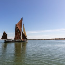 Barge sailing on peaceful day