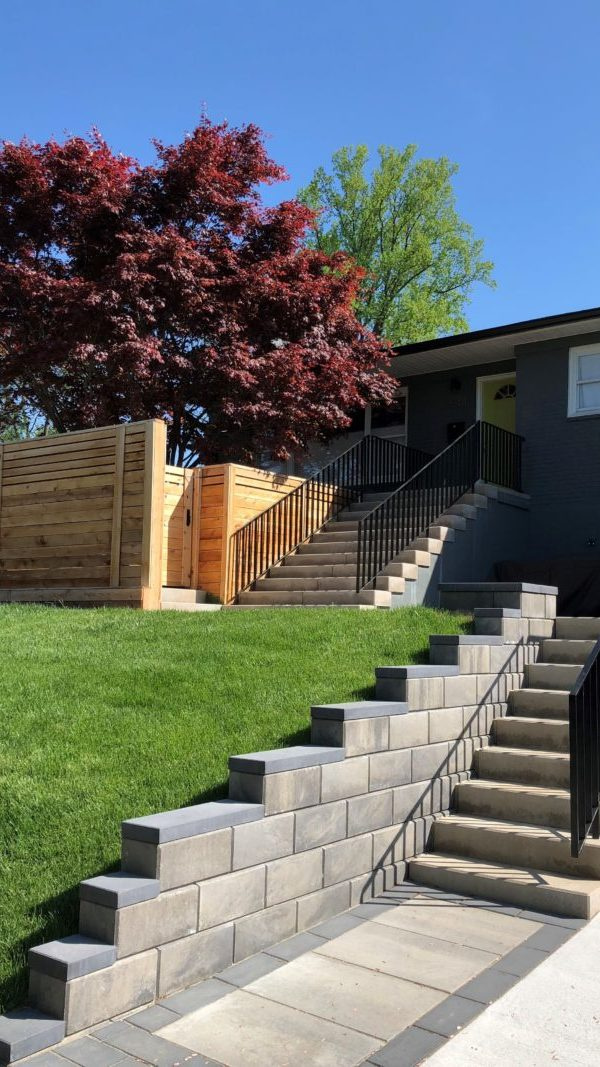 Stone steps, Iron railings, Paver patio, Paver retaining wall, Fence, Sod