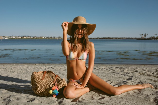 Fun spent at the beach with these summer essentials, a straw bag and hat.