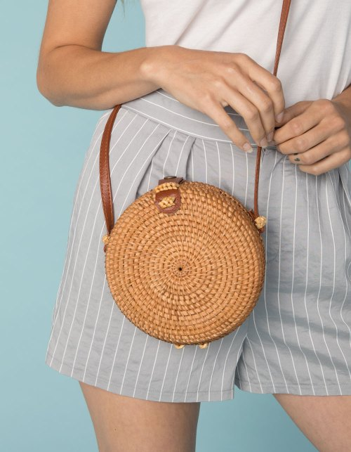 West of Melrose Rattan crossbody bag is on trend and will complement any summer outfit.