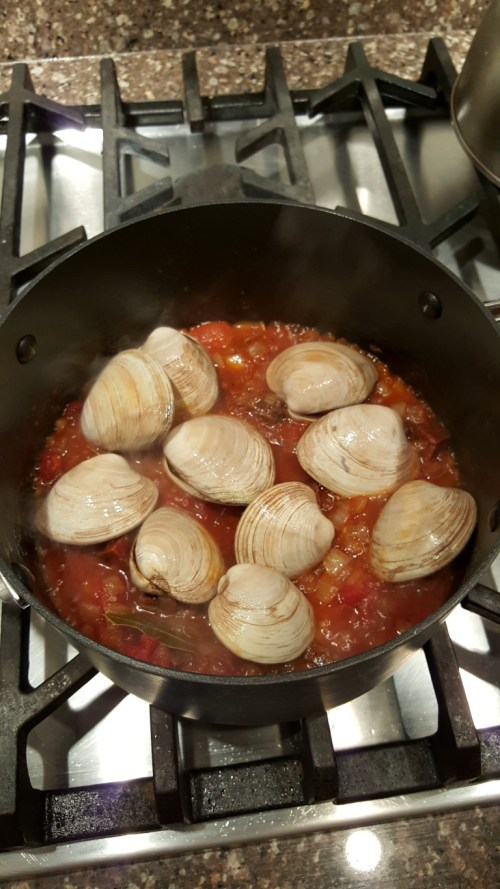 Soaked, cleaned and scrubbed clams are then dumped into the tomato mixture.