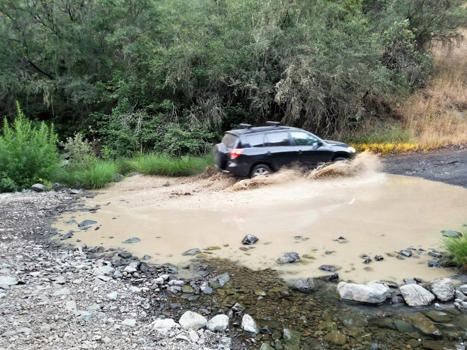 Jeeps blasting through the flood
