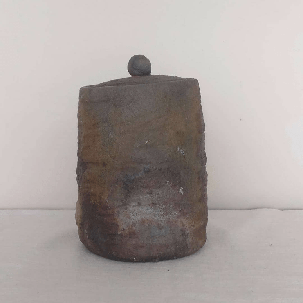 Lidded wood-fired container