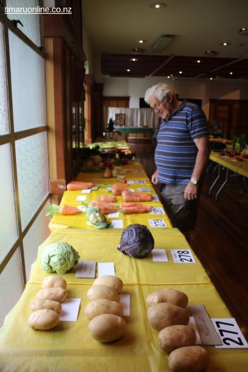 Wally Hayman checks out the vegetable display