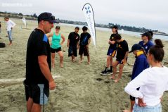 Roncalli College Outdoor Ed students set up the Beach Challenge stations