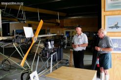Alister Squire and Peter Jost view the 1903 Richard Pearse replica aeroplane.