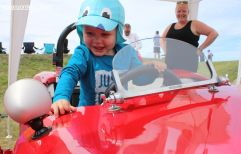 Harrison Mattingly (18 mths) from Rangiora, tries out his grandfather Don Gerard's 1959 Mistral for size