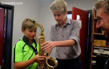 Lucas Rabbidge explains the workings of the saxophone to George Lister.